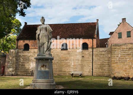Statue of Queen Wilhelmina outside Fort Zeelandia, built in 1651, Paramaribo, Suriname - Stock Photo