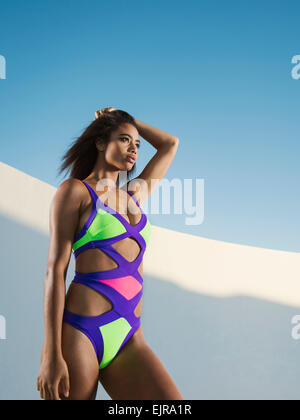 Mixed race woman wearing colorful swimsuit