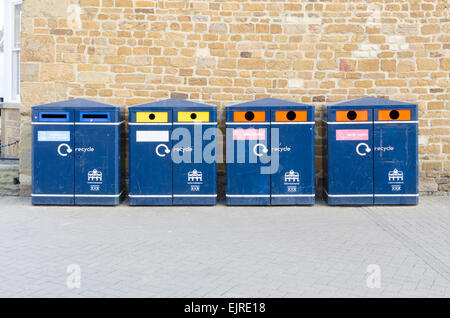 Row of blue public recycling bins in Market Harborough, Leicestershire - Stock Photo