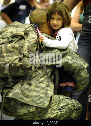 A U.S. Army Soldier hugs his daughter at the Dallas/Fort Worth International Airport in Texas April 3, 2007, after - Stock Photo