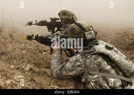 U.S. Army Soldiers from 1st Battalion, 64th Armor Regiment, 2nd Brigade Combat Team, 3rd Infantry Division react - Stock Photo