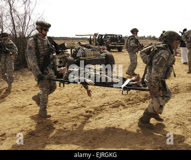 U.S. Army Soldiers from 1st Battalion, 64th Armor Regiment, 2nd Brigade Combat Team, 3rd Infantry Division evacuate - Stock Photo