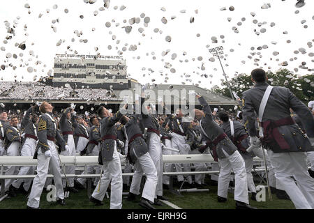 U.S. Military Academy graduates toss their hats during commencement ceremonies at West Point, N.Y., May 23, 2009. - Stock Photo