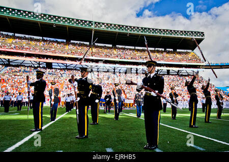 Soldiers assigned to the U.S. Army Drill Team perform at Aloha Stadium during the 2012 National Football League - Stock Photo