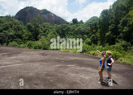 Hikers on Voltzberg Mountain, Central Suriname Nature Reserve, Suriname - Stock Photo