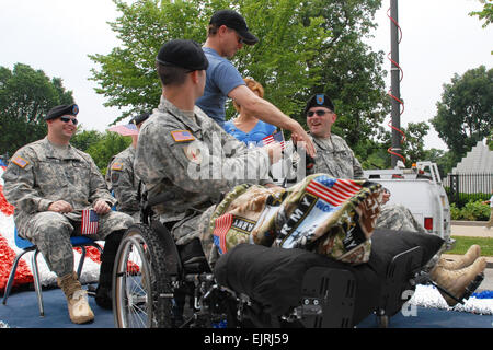 Hollywood actor Gary Sinise shakes hands with the wounded warriors who were the Grand Marshal's of the National - Stock Photo