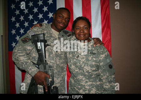CAMP ARIFJAN, Kuwait – On a surprise trip from Iraq, 19-year-old Spc. Anthony W. Avant, Jr. visited his mother, - Stock Photo