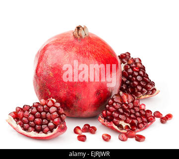 pomegranate with pieces and grains isolated - Stock Photo