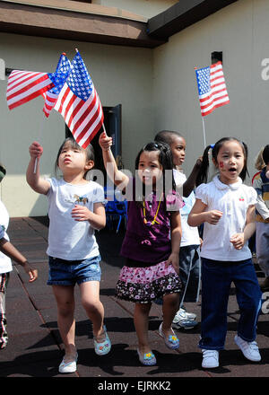 United States Army Garrison Daegu, South Korea Child Development Center students march and wave American flags during - Stock Photo