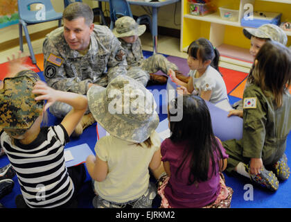 United States Army Garrison Daegu, South Korea commander, Col. Michael P. Saulnier interacts with young members - Stock Photo