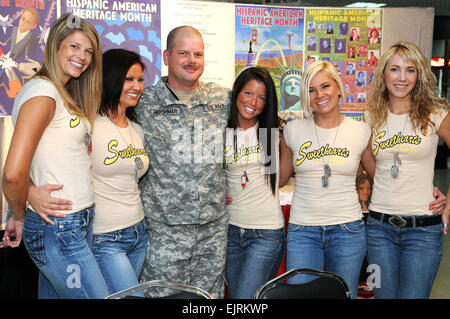 U.S. Army Sgt. Jonathan Hershman, from Atlanta, Ga., poses for a photograph with Sweethearts for Soldiers calendar - Stock Photo