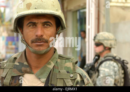 JOINT SECUIRTY STATION ZAFARANIYA, Iraq – An Iraqi Army soldier assigned to 1st Company, 2nd Battalion, 37th Regiment, - Stock Photo