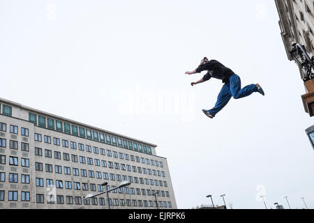 Free Runners practicing Parkour. Parkour is a holistic training discipline enabling practitionaers to get from A - Stock Photo