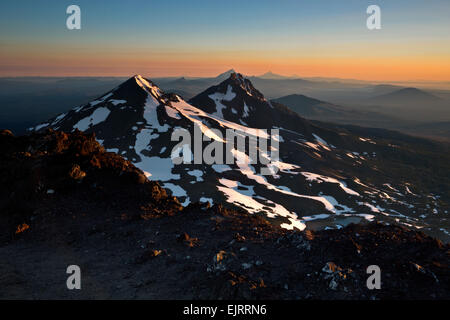 OREGON - Cascade Mountain range volcanoes ranging north from South Sister's crater rim at sunrise with view to Mount - Stock Photo