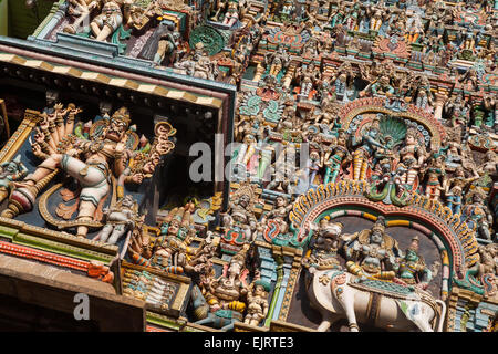 Detail of the sculptures on the gopuram at the Sri Meenakshi Temple in Madurai - Stock Photo