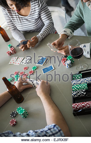 Friends playing poker and drinking - Stock Photo