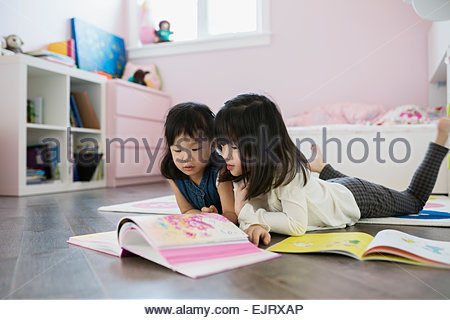 Girl Laying Down And Reading Book Stock Photo Royalty