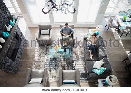 Overhead of couple relaxing in living room - Stock Photo