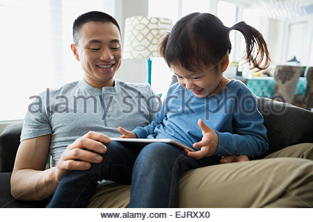 Father and daughter using digital tablet - Stock Photo