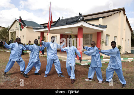 Eldoret, Kenya. 30th Mar, 2015. Students of Moi University who learn Tai Chi pose for group photos beside the Confucius - Stock Photo