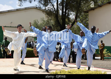 Eldoret, Kenya. 30th Mar, 2015. A teacher from China's Donghua University plays Tai Chi with students of Moi University - Stock Photo