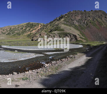 Road to Ala Archa national park in Tian Shan mountain range in Kyrgyzstan - Stock Photo
