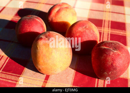Ripe peaches laying on the table - Stock Photo