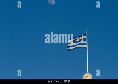 A waxing gibbous moon above a greek flag that flies on a flagpole a waxing gibbous moon above a greek flag that flies on a flagpole stock sciox Image collections