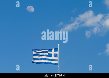 A waxing gibbous moon above a greek flag that flies on a flagpole a waxing gibbous moon above a greek flag that flies on a flagpole with clouds in sciox Image collections