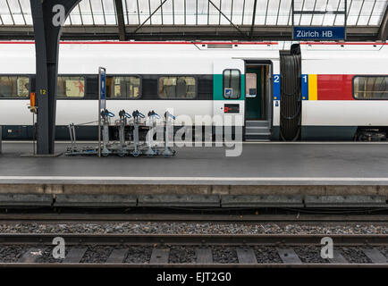 A train of SBB, Switzerland's federal railway operator is waiting with open doors on a platform of Zurich main station. - Stock Photo