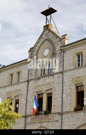 The Town Hall in Tournon-d'Agenais, France, flying the tricolore. - Stock Photo