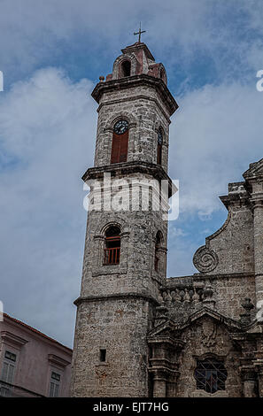 One of the clock towers and part of the Saint Christopher cathedral in Old Havana in Cuba - Stock Photo