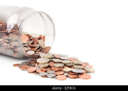 Money Jar full of bank of england coins,pound coins on top - Stock Photo