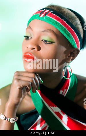 young kenyan woman in national flag colorrs - Stock Photo