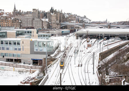 Edinburgh in Winter series with this one looking towards Edinburgh Castle, with Waverley train station in the foreground. - Stock Photo