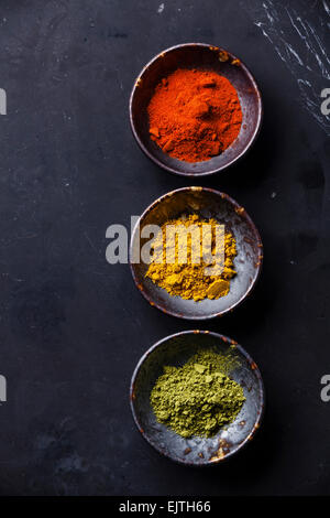 Spices Curry, Paprika, Matcha tea on dark marble background - Stock Photo