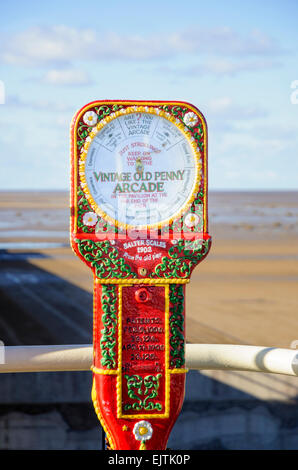 Old style humorous scales on an English seaside pier - very typical of Victorian and Edwardian era Britain; amusement; - Stock Photo