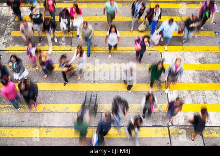 Hong Kong, Hong Kong SAR -November 13, 2014: Crowded pedestrian crossing during rush hour in Hong Kong. - Stock Photo