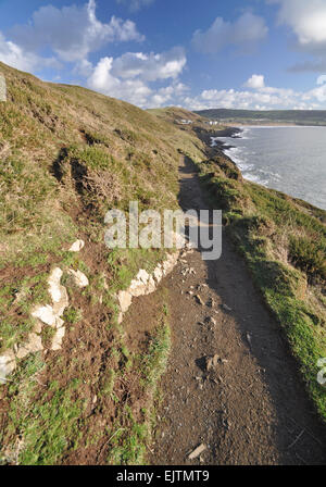 Southwest Coast footpath near Baggy Point headland looking back towards, Croyde, North Devon, England - Stock Photo