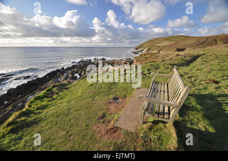 Seat on the southwest coast path, near Croyde village looking towards Baggy Point headland,North Devon, England - Stock Photo