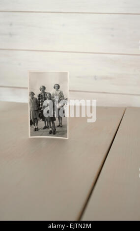Old family photo on a table. - Stock Photo