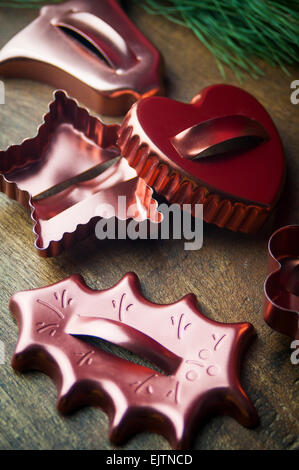 A Close Up of Vintage Copper Holiday Cookie Cutters - Stock Photo