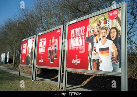 Coca Cola billboard adverts Germany - Stock Photo