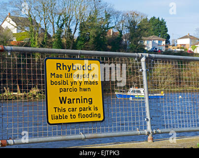 Sign warning that car park is liable to flooding, next to the River Teifi, Cardigan, Ceredigion wales uk - Stock Photo
