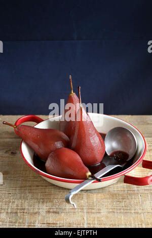 Poached pear in red wine - Stock Photo