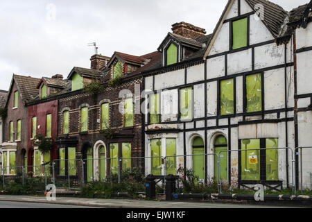 Boarded up terraced house in Liverpool ready for demolition - Stock Photo