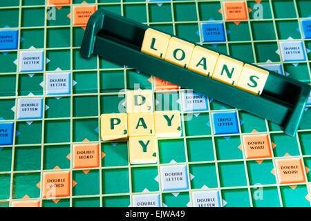 pay day loan loans lending lenders wonga money cash words using scrabble tiles to illustrate spelling spell out - Stock Photo