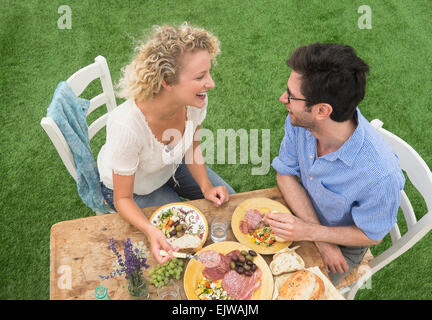 Couple having rustic breakfast - Stock Photo