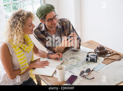 Couple making plans for travel - Stock Photo