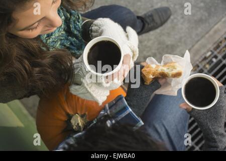 USA, New York State, New York City, Brooklyn, Directly above view of couple drinking coffee - Stock Photo